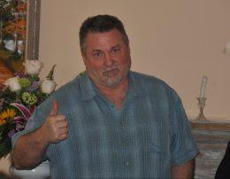 Former Burbank Bulldog tailback, Rick Fruchey gives his thumb's up to Faith Church.